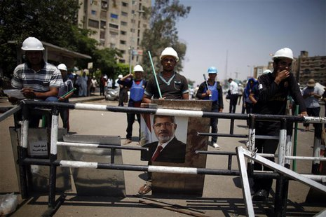 A portrait of deposed Egyptian President Mohamed Mursi is seen at the Raba El-Adwyia mosque square in Cairo July 6, 2013. REUTERS/Khaled Abd