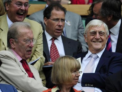 (L-R) British journalist David Frost; Viscount Linley and interviewer Michael Parkinson sit on Centre Court for the semi-final match between
