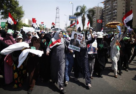 Supporters of deposed Egyptian President Mohamed Mursi march from Raba El-Adwyia square to the Republican Guards headquarters where they bel