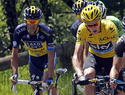 Race leader yellow jersey holder Team Sky rider Christopher Froome of Britain (R) and Team Saxo-Tinkoff rider Alberto Contador of Spain (L)