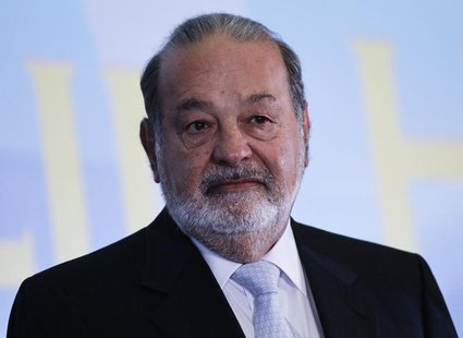 Mexican billionaire Carlos Slim looks on before he gives a speech at Mexico's school of engineers during an event to mark the 50th anniversa