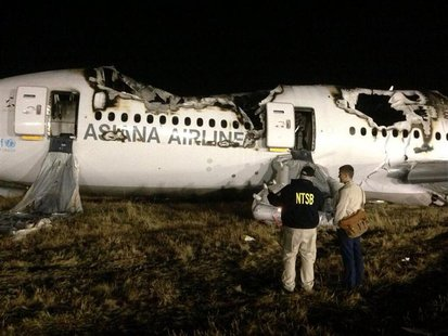 National Transportation Safety Board (NTSB) investigators conduct first site assessment of the wreckage of Asiana Airlines Flight 214, at Sa