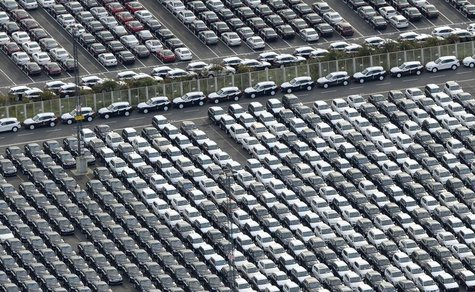 Cars for export stand in a parking area at a shipping terminal in the harbour of the northern German town of Bremerhaven, late October 8, 20