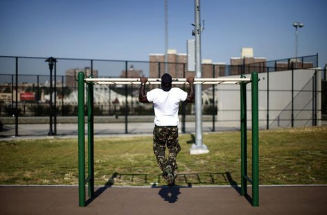 A man works out in an outdoor exercise area at Macombs Dam Park in the Bronx section of New York City, September 13, 2012. REUTERS/Mike Sega