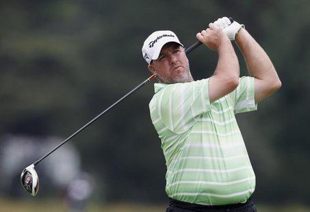 Boo Weekley of the U.S. tees off on the 14th hole during the first round of the 2013 U.S. Open golf championship at the Merion Golf Club in