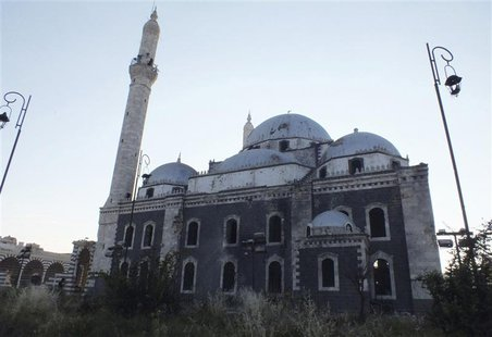 A view of the damaged Khalid ibn al Walid Mosque in Homs in this May 14, 2013 file photo. REUTERS/Yazan Homsy/Files