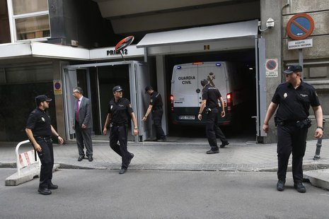A police van believed to be carrying Luis Barcenas, former treasurer for the ruling People's Party, leaves the High Court in Madrid, June 27