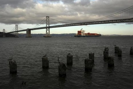 A container ship sails beneath the San Francisco-Oakland Bay Bridge in San Francisco, California March 5, 2013. REUTERS/Robert Galbraith