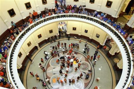 Protesters line the floors of the rotunda at the State Capitol building during a protest before the start of a special session of the Legislature in Austin, Texas July 1, 2013.  REUTERS/Mike Stone