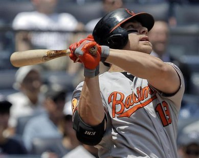 Baltimore Orioles batter Chris Davis watches the ball as he hits a two-run home run against the New York Yankees in the first inning of thei
