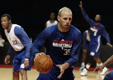 File photo of Chris Kaman (C) controlling the ball during a practice session in Mexico City October 11, 2010. REUTERS/Henry Romero