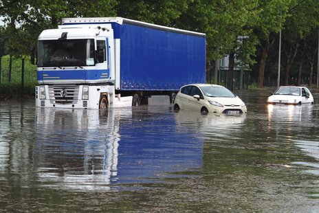 Cars and a lorry are blocked on a street after a heavy thunderstorm with rain caused local flooding in Aulnay sous Bois near Paris, June 19,