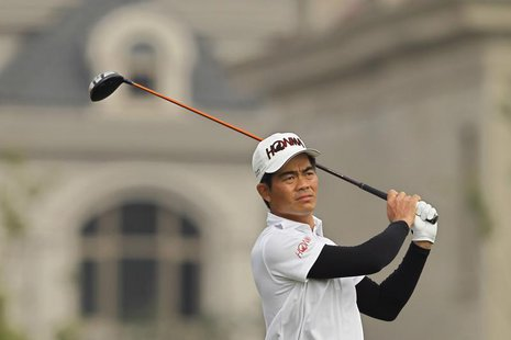 Liang Wenchong of China plays a shot on the first hole during the BMW Masters 2012 golf tournament at Lake Malaren Golf Club in Shanghai, Oc