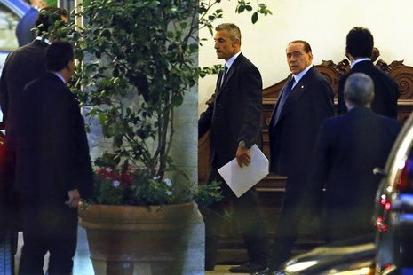 Italy's former Prime Minister Silvio Berlusconi (C) leaves his residence at Grazioli palace, downtown Rome, June 25, 2013. REUTERS/Tony Gent