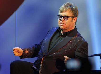 Musician Elton John acknowledges the audience during his performance at the 20th Annual Race to Erase MS benefit gala in Los Angeles May 3,