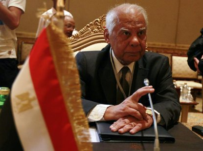 Egypt's Finance Minister Hazem el-Beblawi looks on during a group meeting of Gulf and Arab Finance Ministers in Abu Dhabi, September 7, 2011