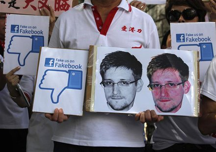 "A demonstrator from the pro-China ""Caring Hong Kong Power"" group protests over claims from former U.S. spy agency contractor Edward Snowden"