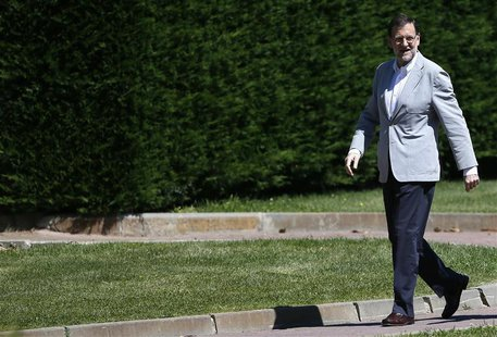 Spain's Prime Minister Mariano Rajoy arrives at an annual FAES conference event in Guadarrama, outside Madrid July 7, 2013. REUTERS/Javier B