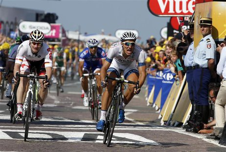 Argos-Shimano team rider Marcel Kittel of Germany crosses the finish line to win the 197 km tenth stage of the centenary Tour de France cycl