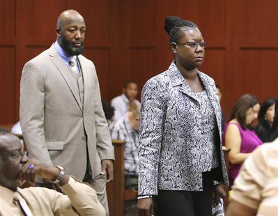 The parents of Trayvon Martin, Tracy Martin and Sybrina Fulton, arrive in the courtroom for the George Zimmerman trial in Seminole circuit c