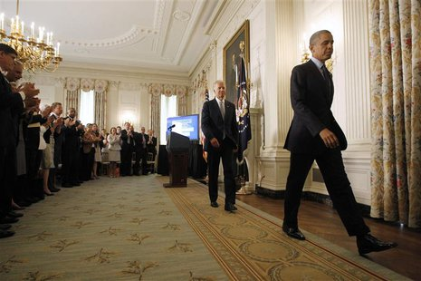 U.S. President Barack Obama (R) leaves with Vice President Joe Biden (2nd L) after delivering remarks on his management agenda in the State