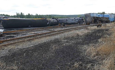 Wagons of the train wreck are seen in Lac Megantic, July 9, 2013. REUTERS/Mathieu Belanger