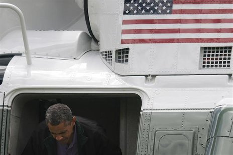 U.S. President Barack Obama ducks his head departing the Marine One helicopter as he returns from a weekend visit at Camp David to the White
