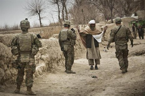 U.S. troops stop a man to search him while on patrol near Command Outpost AJK (short for Azim-Jan-Kariz, a nearby village) in Maiwand Distri