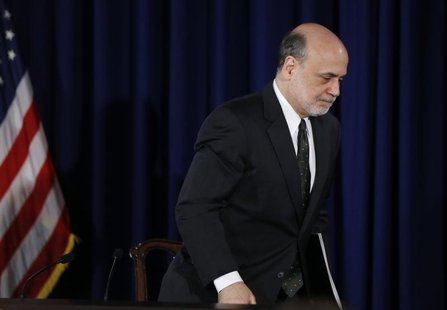 U.S.Federal Reserve Chairman Ben Bernanke departs a news conference following the Fed's two-day policy meeting at the Federal Reserve in Was