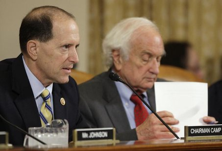 Committee Chairman U.S. Representative Dave Camp (R-MI) (L) and ranking member Representative Sander Levin (D-MI) (R) during a House Ways an