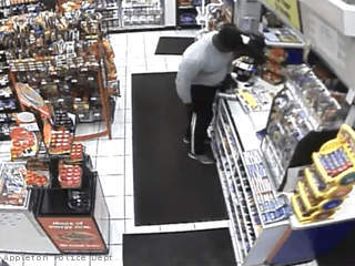 This still frame taken from surveillance video shows a man allegedly taking a wallet from the counter of a convenience store in the 1200 block of W. Wisconsin Ave. in Appleton, July 5, 2013.