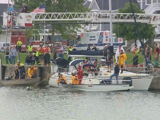 Emergency responders search the channel of the Kewaunee River on Sunday, June 23, 2013. (courtesy of FOX 11).