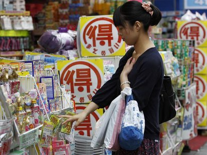 A woman looks at goods outside a drugstore in Tokyo June 28, 2013. REUTERS/Yuya Shino