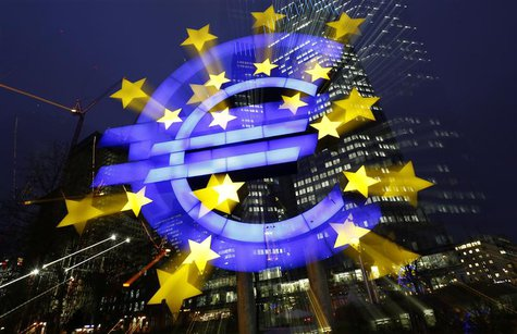 File picture shows an illuminated euro sign in front of the headquarters of the European Central Bank (ECB) in the late evening in Frankfurt