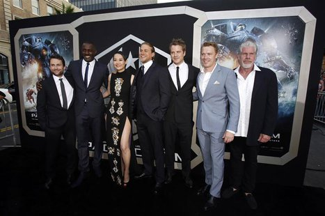 Cast members (L-R) Charlie Day, Idris Elba, Rinko Kikuchi, Charlie Hunnam, Robert Kazinsky, Diego Klattenhoff and Ron Perlman pose at the pr