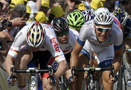(L-R) Lotto-Belisol team rider Andre Greipel of Germany, Omega Pharma-Quick Step team rider Mark Cavendish of Britain and Argos-Shimano team