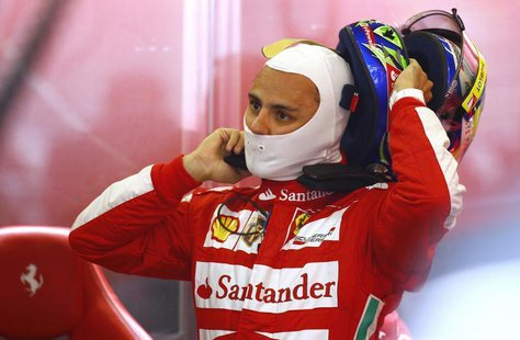 Ferrari Formula One driver Felipe Massa of Brazil takes off his helmet after the first practice session of the German F1 Grand Prix at the N