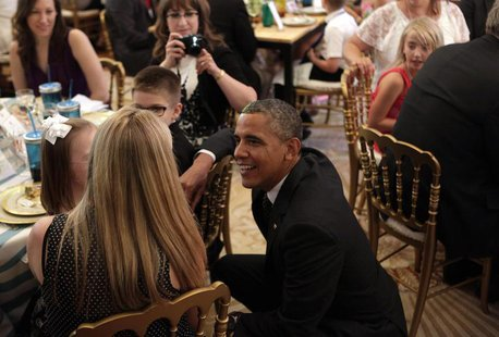 "U.S. President Barack Obama greets guests at the second annual ""Kids' State Dinner"", to honor the winners of a nationwide recipe challenge t"