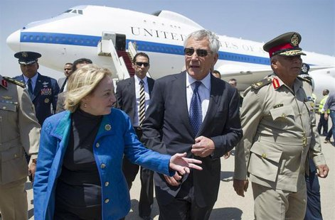 U.S. Defense Secretary Chuck Hagel (C) speaks with U.S. Ambassador to Egypt Anne Patterson and Egyptian Army Chief of Staff Major General Se