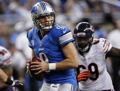 Detroit Lions quarterback Matthew Stafford looks for his receiver while being pressured by the Chicago Bears defense during the second half