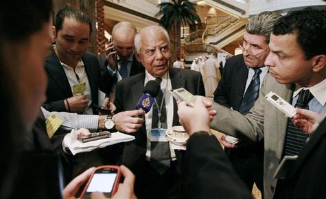 File photo of Egypt's Finance Minister Hazem el-Beblawi speaks to members of the media during a group meeting of Gulf and Arab Finance Minis