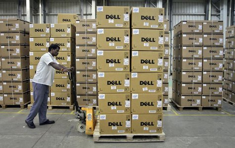 A man pushes a trolley full of Dell computers through a company factory in Sriperumbudur Taluk, in the Kancheepuram district of the southern