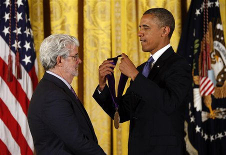 REFILE - ADDITIONAL INFORMATION U.S. President Barack Obama (R) awards the 2012 National Medal of Arts to film producer George Lucas during