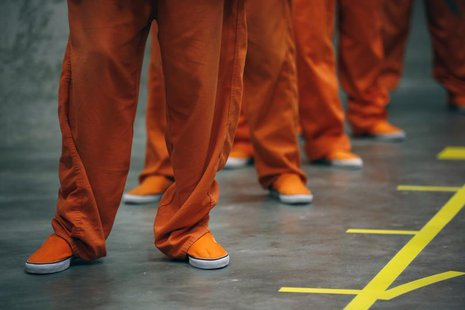 Prison inmates stand in line as they prepare to dance in opposition of violence against women as they participate in a One Billion Rising ev