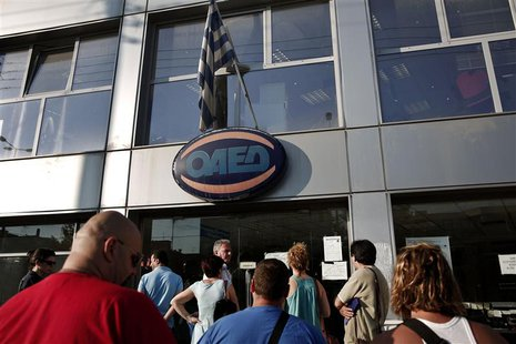 People wait outside a Greek Manpower Employment Organisation (OAED) office in a northern suburb of Athens July 11, 2013. REUTERS/Yorgos Kara