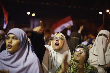 Supporters of the deposed Egyptian President Mohamed Mursi shout anti-army slogans during a sit-in protest in Cairo July 11, 2013. REUTERS/S