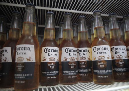 Bottles of Corona beer sit in a fridge at a bar in Cancun June 29, 2012. REUTERS/Victor Ruiz Garcia