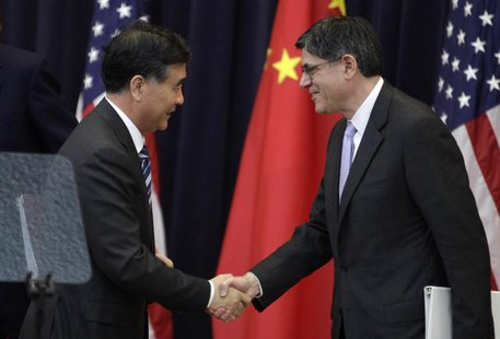 U.S. Treasury Secretary Jack Lew (R) shakes hands with Chinese Vice Premier Wang Yang after the U.S.-China Strategic and Economic Dialogue (
