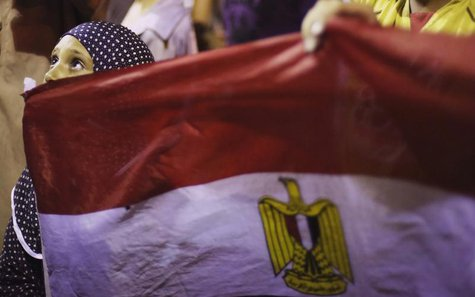 A girl holds Egypt's flag as she attends a sit-in protest organized by supporters of the deposed Egyptian President Mohamed Mursi in Cairo J