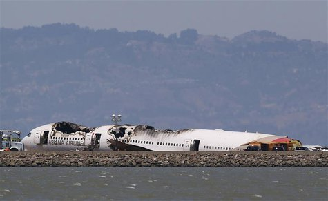 The charred remains of the Asiana Airlines flight 214 sits on the runway at San Francisco International Airport in San Francisco, California